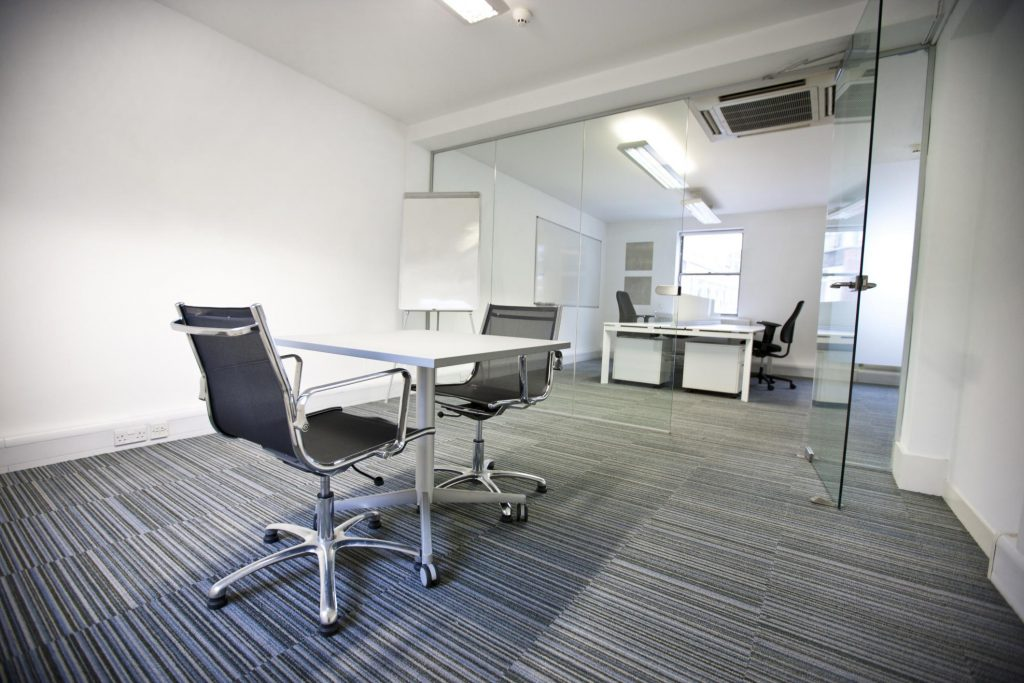 clean office with glass wall barrier