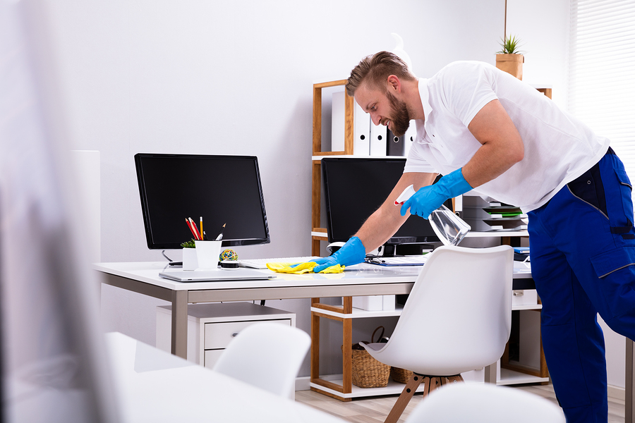 man cleaning the minimalist office room