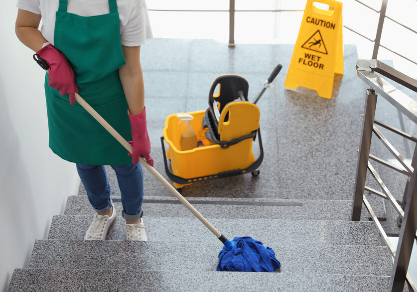 girl cleaning the tile stairs using a mop